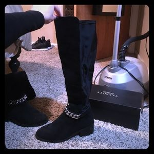 Tall black boots with gold chain. Worn twice.